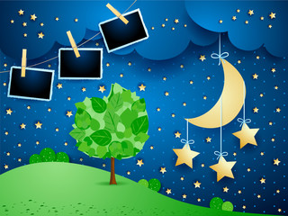 Surreal landscape by night with hanging stars and photo frames