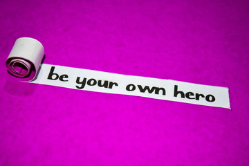 Be your own hero text, Inspiration, Motivation and business concept on purple torn paper