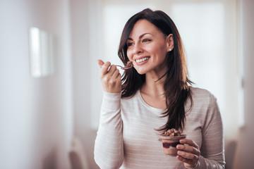 Beautiful woman eating dessert.