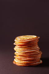 stack of dried orange slices on a dark background