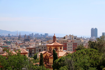 Aerial view of Barcelona, Spain from Montjuïc hill on a sunny day.