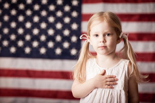 Little Girl Honoring American Flag