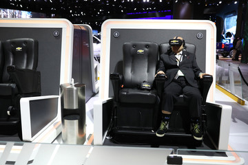 A reporter uses a virtual reality machine at the Chevrolet display at the North American International Auto Show in Detroit, Michigan