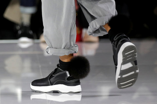 A model presents a shoes creation by designer Fumito Ganryu as part of his Fall/Winter 2019-2020 collection show during Men's Fashion Week in Paris
