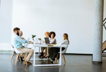 Joyful multiracial business team at work in modern office