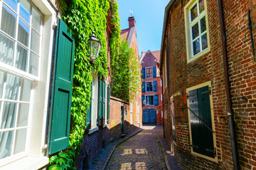 Foto auf Acrylglas Schmale Gasse picturesque alley in Leer, Ostfriesland, Germany