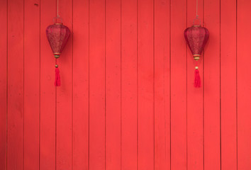 red chinese lanterns on the red wall