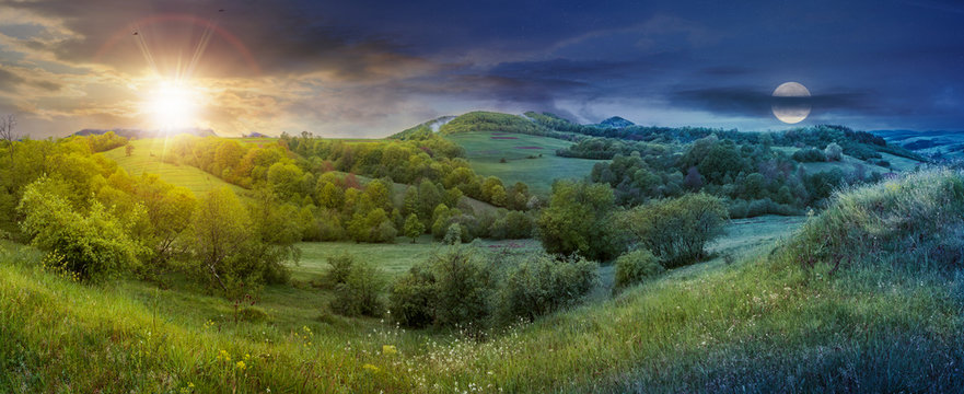 panorama of time change in springtime countryside with sun and moon. grassy hills and meadows. trees with green foliage on hillsides. mountain top in the distance. wonderful nature scenery
