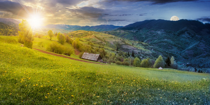 time change above the rural field with dandelions in mountains. beautiful springtime landscape with sun and moon. village in the distance valley.