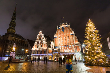 City Hall Square with House of the Blackheads and Saint Peter church in Old Town of Riga at night during Christmas, Latvia
