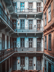 Inner yard of old historical apartment building in Budapest city, Hungary