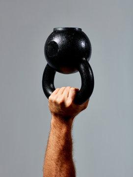 hand holding kettle bell