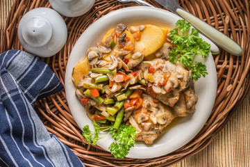 Fillet of chicken legs with stewed vegetables.