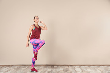 Young beautiful woman doing exercise at home, space for text. Workout and fitness