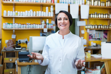 Woman in white coat promoting health supplements in drugstore