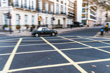 Classic car speeding on a London road