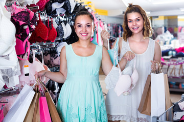 Two girls are holding purchases