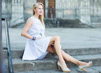 portrait of woman sitting on steps