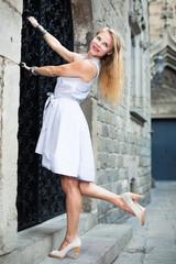 portrait of cheerful female near the door
