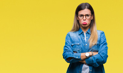 Young beautiful woman over wearing glasses over isolated background depressed and worry for distress, crying angry and afraid. Sad expression.