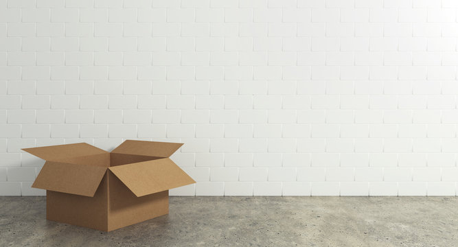 Empty open cardboard box on the floor with a wall background. Concept of moving and shipping