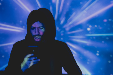 Attractive young man with beard taking pictures in a futuristic environment