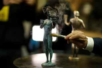 "A worker applies a patina on ""The Actor"" statuette during a media event on the production of the statuettes for the 25th annual Screen Actors Guild Awards at American Fine Arts Foundry in Burbank"