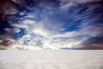 Wall Mural - Business concept - Empty concrete floor top with morning grey dark cloudy sky for display or montage product
