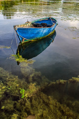 an old blue fishing boat