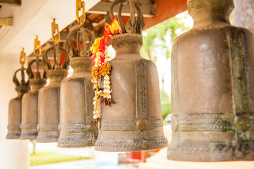 Wall Mural - Row of bells in buddhist temple in Thailand