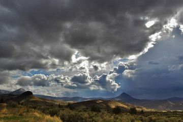Hills with storm clouds brewing in the high desert.