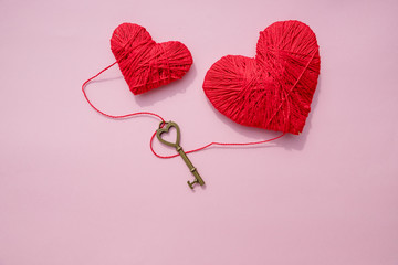 Valentines day card with red hearts and key.Red Hearts with Golden Key Rustic.Happy Valentines Day Decoration.Key of my heart concept.14 February.