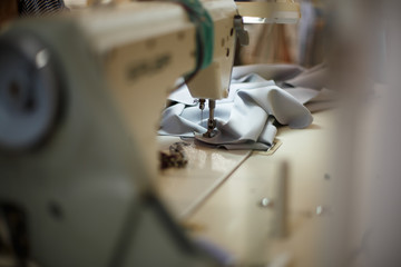 Close-up of a sewing machine with light on. workplace tailor. sewing industry