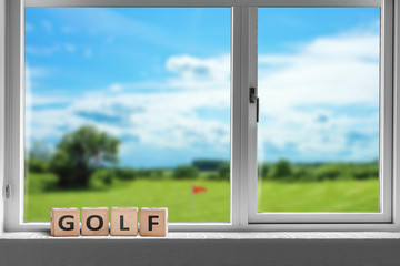 Golf sign in a window with a view to a golf course