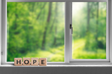 Hope sign in a window sill with a view