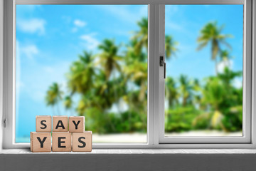 Say yes sign in a window on a tropical beach