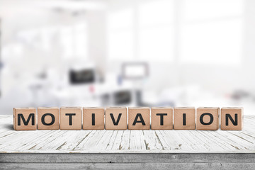 Motivation sign on a desk in a bright office