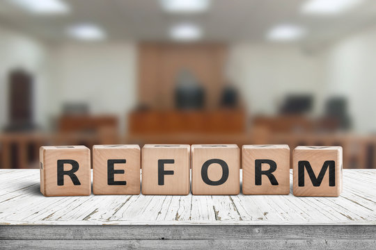 Reform sign on a desk with a blurry background