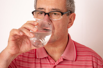 Man drinks water from the glass