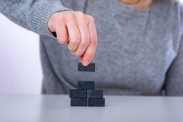 Construct with wooden blocks