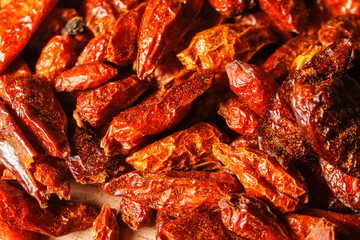 Dried red chili peppers, type pipi piri or capsicum frutescens macro background