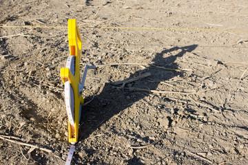 Roulette geodesic 100 meters on floor sand