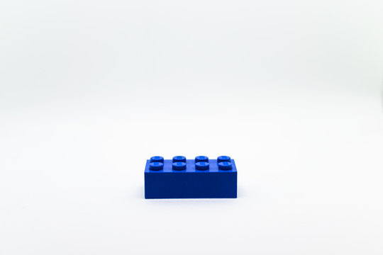A blue little Lego block isolated on white background