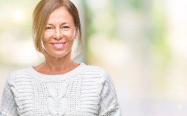 Middle age senior hispanic woman wearing winter sweater over isolated background with a happy and cool smile on face. Lucky person.