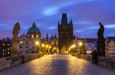 Morning view of Charles Bridge in Prague, Czech Republic. The Charles Bridge is one of the most visited sights in Prague. Architecture and landmark of Prague