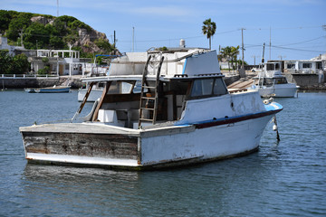 An old and abandoned yacht in the harbor of Mazathlan-Mexico.