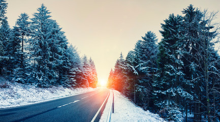 Winter landscape, Winter Forest,  Winter road and trees covered with snow, Road Through A Winter Forest At Beautiful Sunrise
