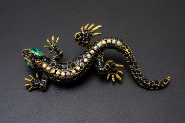 Wall Mural - gold brooch lizard with gems isolated on black