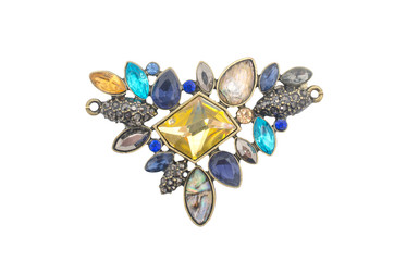 Wall Mural - brooch with colored gems isolated on white