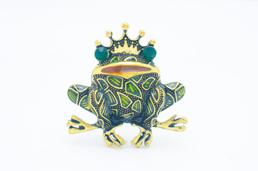 Wall Mural - golden enamelled brooch frog wearing a crown isolated on white